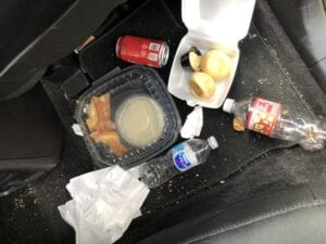 car garbage on floor needs Tossits