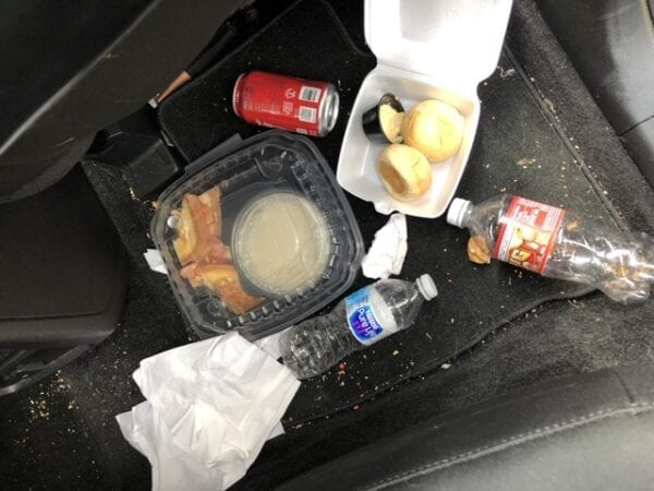 car garbage on floor needs Tossits